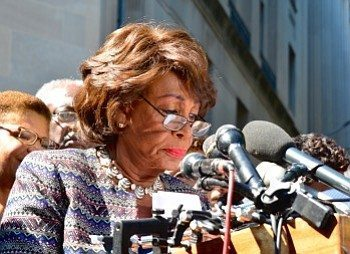 Rep. Maxine Waters (D-California) reads a letter from members of the Congressional Black Caucus calling for Attorney General Loretta Lynch to investigate the killings of unarmed blacks by law enforcement officials during a Sept. 22 news conference outside the Justice Department headquarters in D.C. Photo by Travis Riddick