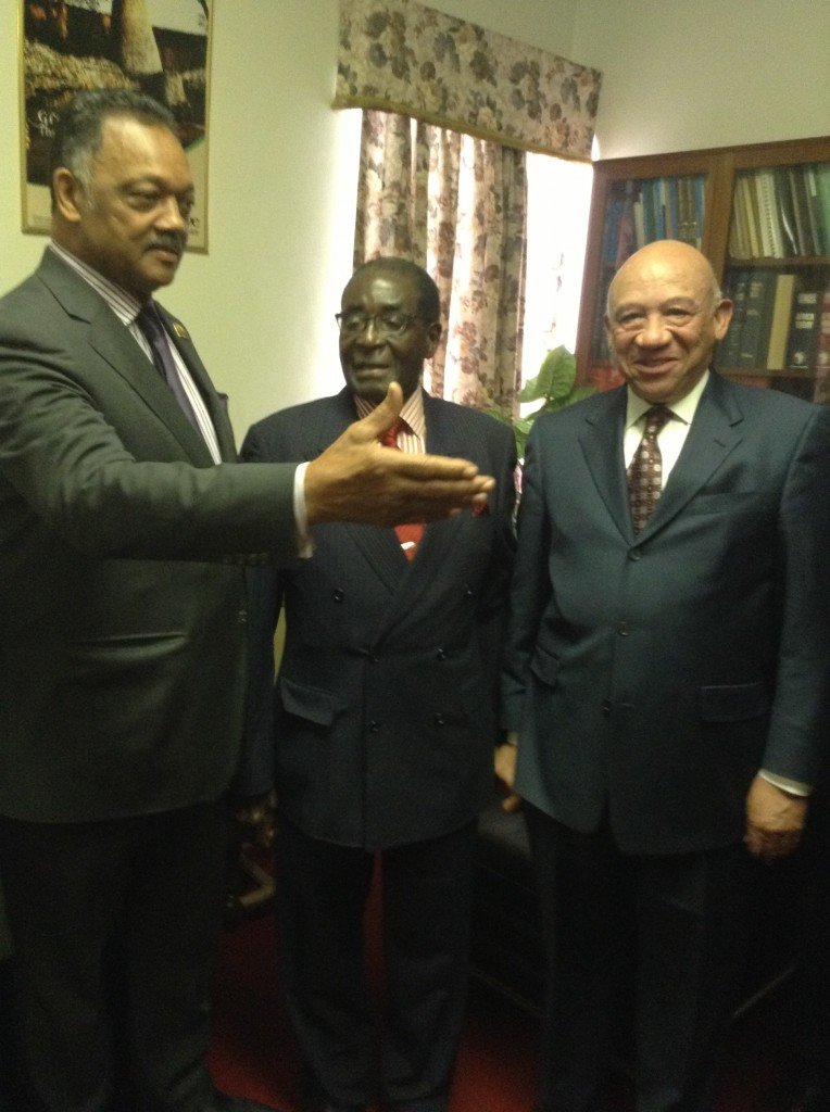 Jesse Jackson (left) makes a point with Zimbabwe President Robert Mugabe (center) and Chicago businessman Elzie L. Higginbottom (NNPA Photo by George E. Curry)