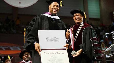 Michael Strahan is presented an honorary degree by Texas Southern University President  John Rudley