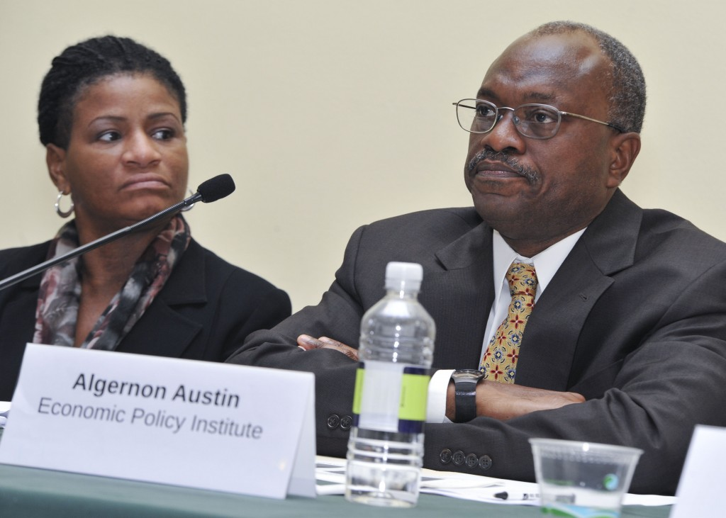 Algernon Austin (right), director of the Program on Race, Ethnicity, and the Economy at the Economic Policy Institute speaks on a panel about job opportunities in the transportation industry on Capitol Hill as Michelle Holder, senior labor market analyst at the Community Service Society of New York looks on (Freddie Allen/NNPA News Wire/Sept. 26, 2012).