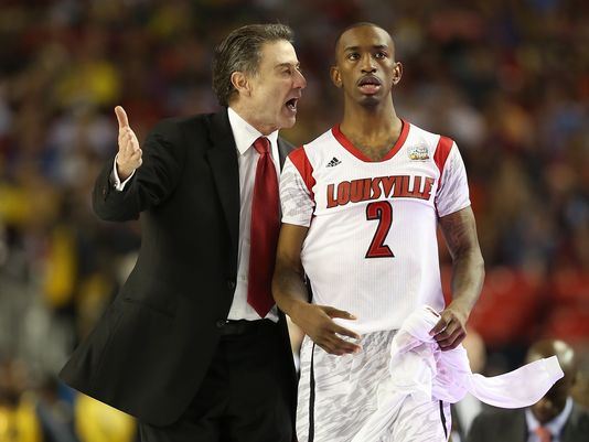Russ Smith, right, returns to Rick Pitino's backcourt after bypassing a chance at the NBA. (Photo: Andy Lyons Getty Images)
