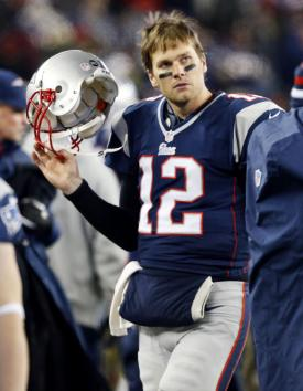New England Patriots quarterback Tom Brady (12), shown during the AFC playoffs last January, reportedly tore two ligaments in his left knee and may miss the season. UPI/John Angelillo