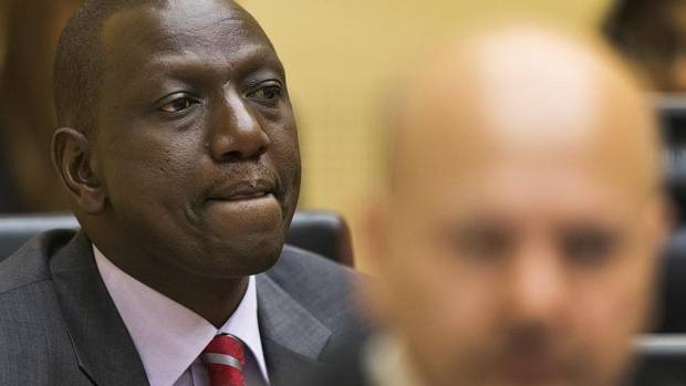Kenya's Deputy President William Ruto, left, awaits the start of his trial in the courtroom of the International Criminal Court (ICC) in The Hague, Netherlands, Tuesday, Sept. 10, 2013. (MICHAEL KOOREN/AP)