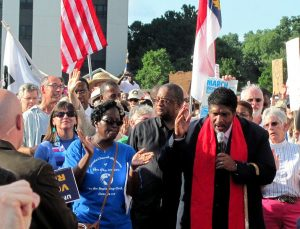 Rev. Dr. William Barber speaking at a Moral Monday rally.