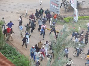 Crowds flee mall in Nairobi as gunfire erupts.