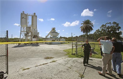 In this Sept. 10, 2013 file photo, Polk County Sheriff personnel investigate the death of 12-year-old girl, Rebecca Ann Sedwick, at an old cement plant in Lakeland, Fla. Two girls have been arrested in her death. Officials say she committed suicide after being bullied online for nearly a year. On Tuesday, Oct. 15, 2013 Polk County Sheriff Grady Judd will announce  charges against the girls, age 12 and 14, in a press conference.  (AP Photo/The Lakeland Ledger, Ernst Peters, File)
