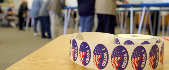 "A roll of ""I Voted"" stickers is photographed on one of the check-out station tables at Barnstable Town Hall in Hyannis, Mass., Tuesday, Nov. 2, 2004. Voters were offered a sticker after casting their ballots. (AP Photo/Julia Cumes)"