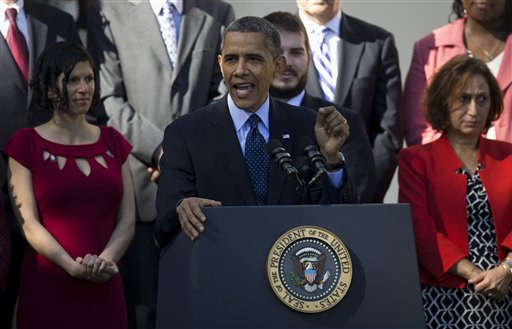 President Barack Obama gestures while speaking in the Rose Garden of the White House in Washington, Monday, Oct. 21, 2013, on the initial rollout of the health care overhaul. (AP Photo/ Evan Vucci)