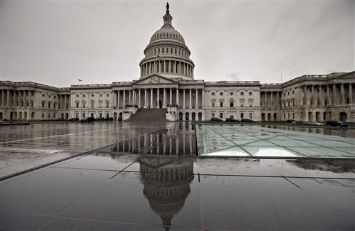 "In this Oct. 7, 2013, photo. the U.S. Capitol is reflected during rain in Washington. Americans are finding little they like about President Barack Obama or either political party, according to a new poll that suggests the possibility of a ""throw the bums out"" mentality in next year's midterm elections. (AP Photo/J. Scott Applewhite)"