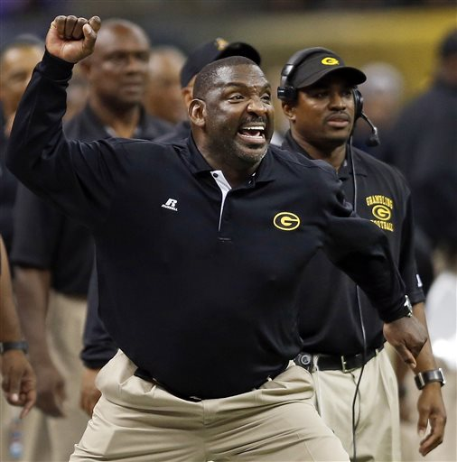 """FILE - In this Nov. 24, 2012, file photo, Grambling State coach Doug Williams reacts after a play against Southern University during the Bayou Classic college football game in New Orleans. Grambling players say they are ending their boycott after speaking with former coach Doug Williams, who advised them to, """"Go out there and play football.""""  (AP Photo/The Times-Picayune, Brett Duke)"""