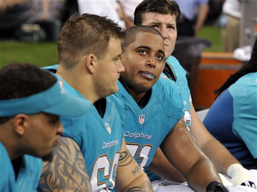 In this Sept. 30, 2013 file photo, Miami Dolphins guard Richie Incognito (68), center left, and  and tackle Jonathan Martin (71), center right, sit on the bench in the second half of an NFL football game against the New Orleans Saints in New Orleans. About halfway between the start of exhibition games and the Super Bowl, there have been plenty of unwanted story lines. Bullying in the locker room, coaches collapsing, serious injuries to marquee players, the D.C. Council's call on Washington's pro football team to change its name _ examples from the past week alone. (AP Photo/Bill Feig, File)