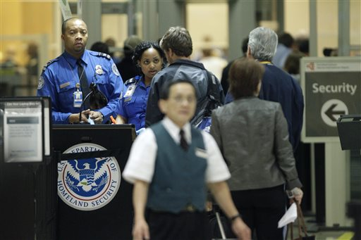 In this Thursday, Nov. 18, 2010 file photo, TSA officials check check passengers entering a security checkpoint at Hartsfield-Jackson Atlanta International Airport in Atlanta. A federal probe of a Transportation Security Administration program to screen suspicious behavior of passengers at airports suggests the effort, which has cost almost $1 billion since 2007, has not been proven effective, according to a report released Wednesday, Nov. 13, 2013. (AP Photo/David Goldman, File)