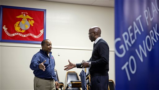 In this Thursday, Nov. 14, 2013, file photo, retired U.S. Army Sgt. 1st Class Duane Stubbs, right, of Morrow, Ga., shakes hands with retired U.S. Army 1st Sgt. Leland Smith, CEO of SolidHires, during a job fair for veterans at the VFW Post 2681, in Marietta, Ga. The Labor Department reports on the number of Americans who applied for unemployment benefits last week on Wednesday, Nov. 27, 2013. (AP Photo/David Goldman, File)