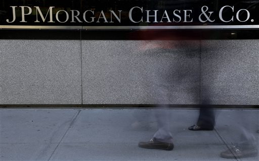 The JPMorgan Chase & Co. logo is displayed at their headquarters in New York, in this Monday, Oct. 21, 2013, file photo. A person close to the talks says the Justice Department and JPMorgan Chase & Co. have reached agreement on all issues in a $13 billion settlement of a civil inquiry into the company's sales of low-quality mortgage-backed securities that collapsed in value in the financial crisis. (AP Photo/Seth Wenig, File)
