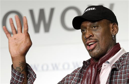 In this Oct. 25, 2013, file photo, former basketball player Dennis Rodman waves during a news conference to promote a Japanese cable network's coverage of the upcoming NBA season, in Tokyo The former Chicago Bulls player's Rodman-themed vodka, that was consumed with friend and North Korean leader Kim Jong Un, is set to debut Thursday, Nov. 21. (AP Photo/Shizuo Kambayashi, File)