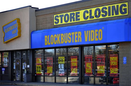 This March 17, 2010, file photo, shows a closing Blockbuster stores in Racine, Wis. Dish Network announced Wednesday, Nov. 6, 2013, it will close the remaining 300 Blockbuster locations scattered across the United States. Dish Network expects the stores to be closed by early January. Dish Network says about 2,800 people will lose their jobs. (AP Photo/Journal Times, Scott Anderson, File)