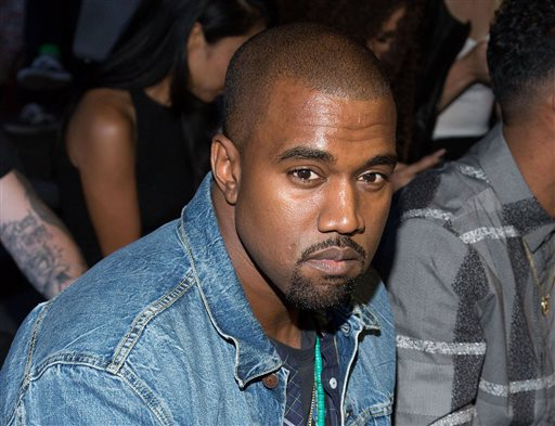 """In this Sept. 7, 2012, file photo, Kanye West attend at the Alexander Wang collection during Mercedes-Benz Fashion Week in New York.West continued to vent at former partner Nike, taking to the mic during a concert again this week to complain about his treatment by the sports apparel company. West spent more than 6 minutes talking and singing about the company during his """"The Yeezus Tour"""" stop Wednesday night, Nov. 27, 2013, in Nashville, Tenn. (Photo by Dario Cantatore/Invision/AP, File)"""
