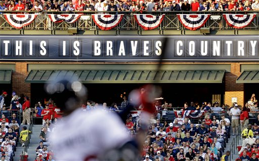 In this April 1, 2013 file photo, fans watch from the outfield as Atlanta Braves' Jason Heyward swings at a pitch in the first inning of an opening day baseball game against the Philadelphia Phillies, in Atlanta. The Atlanta Braves are leaving Turner Field and moving into a new 42,000-seat, $672 million stadium complex in Cobb County in 2017. Braves executives John Schuerholz, Mike Plant and Derek Schiller said Monday, Nov. 11, 2013, that the team decided not to seek another 20-year lease at Turner Field and began talks with the Cobb Marietta Coliseum and Exhibit Hall Authority in July.(AP Photo/David Goldman, File)