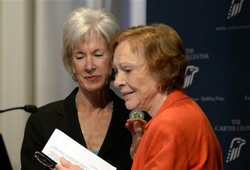 Former First Lady Rosalynn Carter, right, thanks Department of Health and Human Services Secretary Kathleen Sebelius,  after Sebelius announced easier access to mental health care during the 29th annual mental health policy symposium at the Carter Center on Friday, Nov. 8, 2013, in Atlanta. (AP Photo/David Tulis)