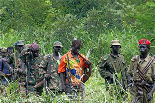 In this July 31, 2006 file photo, members of Uganda's Lord's Resistance Army (LRA) are seen as their leader Joseph Kony meets with a delegation of Ugandan officials and lawmakers and representatives from non-governmental organizations, in the Democratic Republic of Congo near the Sudanese border. Adventurer Robert Young Pelton, whose crowd-funding scheme has already drawn criticism from a pair of Africa experts, is the latest to join a line of private individuals and aid groups who are trying to corner Joseph Kony and the members of his Lord's Resistance Army. (AP Photo, File)