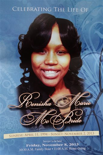 The front cover of a funeral service program for 19-year-old Renisha McBride at House of Prayer & Praise Cathedral in Detroit on Friday, Nov. 8, 2013. McBride was shot and killed by a Dearborn Heights home owner in the early morning hours of Saturday, November 2 after she approached his house. About two hours before the shooting, McBride had been involved in an auto accident nearby.  (AP Photo/Detroit Free Press, Brian Kaufman)