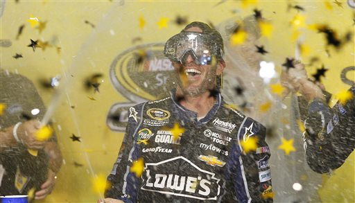Jimmie Johnson celebrates after winning his sixth NASCAR Sprint Cup Series auto race title in eight years in Homestead, Fla., Sunday, Nov. 17, 2013. (AP Photo/Terry Renna)