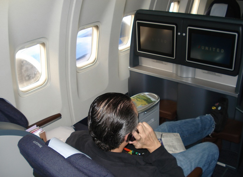 People Talking on Cellphone on Plane