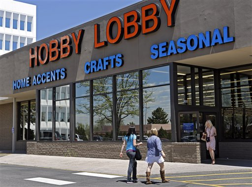 This May 22, 2013 file photo shows customer at a Hobby Lobby store in Denver. The Supreme Court has agreed to referee another dispute over President Barack Obama's health care law, whether businesses can use religious objections to escape a requirement to cover birth control for employees. The justices said Tuesday they will take up an issue that has divided the lower courts in the face of roughly 40 lawsuits from for-profit companies asking to be spared from having to cover some or all forms of contraception. The court will consider two cases. One involves Hobby Lobby Inc., an Oklahoma City-based arts and crafts chain with 13,000 full-time employees. Hobby Lobby won in the lower courts. (AP Photo/Ed Andrieski, File)