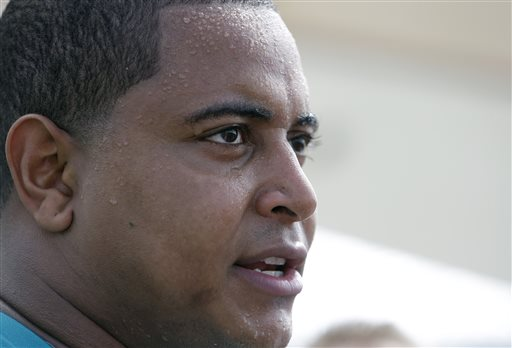In this July 22, 2013, file photo, Miami Dolphins tackle Jonathan Martin in interviewed after an NFL football practice in Davie, Fla. In the stadium program sold at the Miami Dolphins' game on Halloween, Richie Incognito was asked who's the easiest teammate to scare. His answer: Jonathan Martin.  The troubled, troubling relationship between the two offensive linemen took an ominous turn Monday, Nov. 4, 2013, with fresh revelations: Incognito sent text messages to his teammate that were racist and threatening, two people familiar with the situation said.(AP Photo/Lynne Sladky, File)