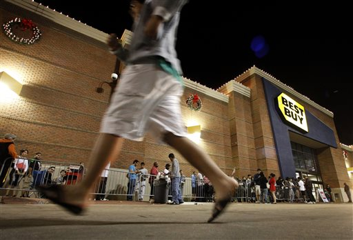 n this Thursday, Nov. 22, 2012, file photo, shoppers stand in line outside a Best Buy department store before the store's opening at midnight. Thanksgiving is slowly becoming just another shopping day as at least a dozen major retailers are planing to open Thursday, Nov. 28, 2013. (AP Photo/Tony Gutierrez, File)