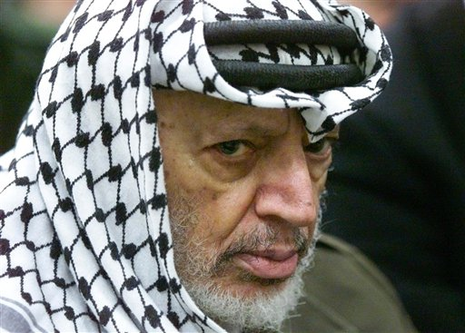 In this May 31, 2002 file photo, Palestinian leader Yasser Arafat pauses during the weekly Muslim Friday prayers in his headquarters in the West Bank city of Ramallah. Al-Jazeera is reporting that a team of Swiss scientists has found moderate evidence that longtime Palestinian leader Arafat died of poisoning. The Arab satellite channel published a copy of what it said was the scientists' report on its website on Wednesday, Nov. 6, 2013.(AP Photo/Lefteris Pitarakis, File)