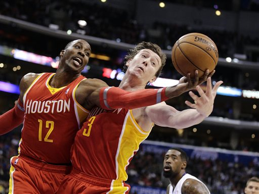 Houston Rockets' Dwight Howard, left, and Omer Asik, of Turkey, reach for a rebound during the first half of an NBA basketball game against the Los Angeles Clippers on Monday, Nov. 4, 2013, in Los Angeles. The Clippers won 137-118. (AP Photo/Jae C. Hong)