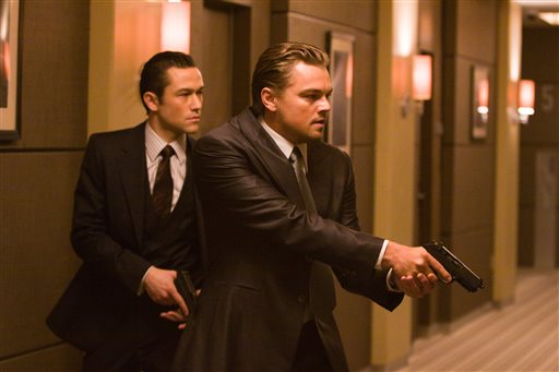 "In this film publicity image released by Warner Bros., Joseph Gordon Levitt, left, and Leonardo DiCaprio are shown in a scene from ""Inception.""  Gun violence in PG-13 rated movies has increased considerably in recent decades, to the point that it sometimes exceeds gun violence in even R-rated films, according to a study released Monday. Ohio State University and the Annenberg Public Policy Center at the University of Pennsylvania surveyed gun violence in top-grossing movies, finding that it had more than tripled in PG-13 films since 1985. (AP Photo/Warner Bros., Stephen Vaughan)"