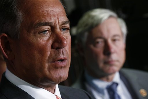 House Speaker John Boehner of Ohio, accompanied by House Energy and Commerce Committee Chairman Rep. Fred Upton, R-Mich., which has responsibility over matters relating to healthcare, speaks about President Obama's health care law after Republican lawmakers met at the Republican National Committee headquarters in Washington, Wednesday, Nov. 13, 2013. Upton has proposed a bill that would allow insurers to keep selling insurance that doesn't offer the type of benefits required by Obama's health care law. (AP Photo/Charles Dharapak)