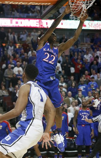 Kansas guard Andrew Wiggins dunks the ball over Duke forward Jabari Parker during the second half of an NCAA college basketball game Tuesday, Nov. 12, 2013, in Chicago. Kansas won 94-83. (AP Photo/Charles Rex Arbogast)