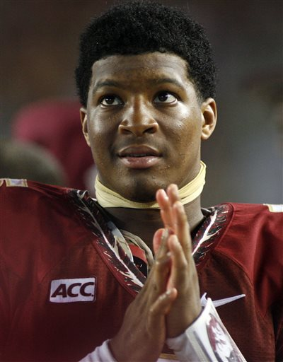 In this Sept. 21, 2013, file photo, Florida State quarterback Jameis Winston watches from the sidelines during the second half of an NCAA college football game against Bethune-Cookman in Tallahassee, Fla. Winston is under investigation in an alleged sexual assault reported nearly a nearly a year ago, the university and Winston's attorney confirmed on Wednesday, Nov. 13, 2013. (AP Photo/Phil Sears, File)