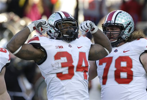 Ohio State running back Carlos Hyde (34) reacts after his touchdown during the second half of an NCAA college football game against Michigan in Ann Arbor, Mich., Saturday, Nov. 30, 2013. Ohio State defeated Michigan 42-41. (AP Photo/Carlos Osorio)