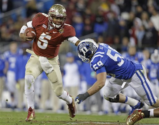 Florida State's Jameis Winston (5) scrambles as Duke's Kelby Brown (59) defends in the first half of the Atlantic Coast Conference Championship NCAA football game in Charlotte, N.C., Saturday, Dec. 7, 2013. (AP Photo/Bob Leverone)