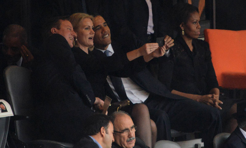 President Obama takes selfie during Mandela Memorial