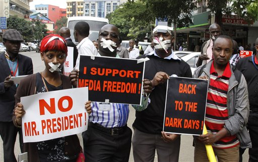 Kenyan Journalists demonstrators display placards during a protest against the Media Bill in Nairobi, Kenya, Tuesday, Dec. 3, 2013. A media protest was called on by various media houses to protest new draconian laws that are being tabled by parliament.(AP Photo/Khalil Senosi)