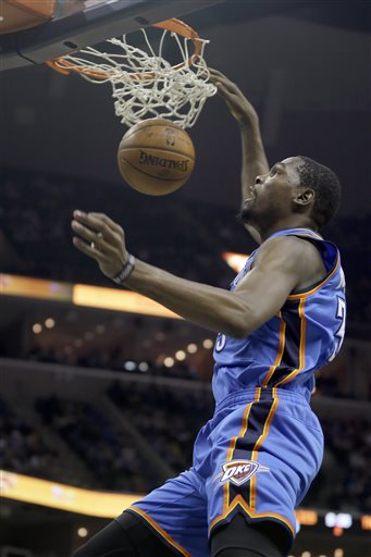 Oklahoma City Thunder's Kevin Durant dunks the ball in the first half of an NBA basketball game against the Memphis Grizzlies in Memphis, Tenn., Wednesday, Dec. 11, 2013. (AP Photo/Danny Johnston)