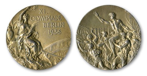 This handout provided by SCP Auctions, Inc., shows the front, left, and back, right, of one of Jesse Owens' four gold medals won at the 1936 Olympics in Berlin. SCP Auctions says the medal could go for more than $1 million when the auction opens.  (AP Photo/SCP Auctions, Inc.)
