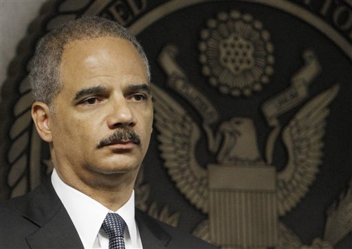 "In this July 16, 2010 file photo, Attorney General Eric Holder takes part in news conference in Miami. The Obama administration is issuing new recommendations Wednesday Jan. 8, 2014 on classroom discipline that seek to end the apparent disparities in how students of different races are punished for violating school rules. Holder said the problem often stems from well intentioned ""zero-tolerance"" policies that too often inject the criminal justice system into the resolution of problems. (AP Photo/Alan Diaz, File)"
