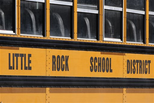 A school bus is parked near Little Rock Central High School in Little Rock, Ark., Monday, Jan.13, 2014. A federal judge began hearing arguments Monday about whether to approve a settlement agreement that would allow the state to stop making payments to help fund racial integration in three Little Rock-area school districts. (AP Photo/Danny Johnston)