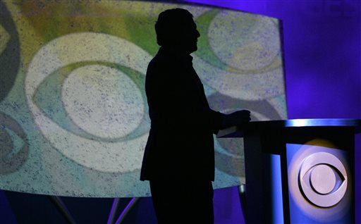 In this Jan. 9, 2007, file photo,  Leslie Moonves, president and CEO of CBS Corp., is silhouetted while watching a video presentation during his keynote speech at the Consumer Electronics Show in Las Vegas . Thanks to football and a slate of robust comedy and drama shows, CBS clobbered its prime-time competition for the first full week of 2014. (AP Photo/Jae C. Hong, file)