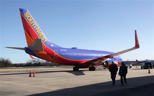 Southwest Airlines Flight 4013 sits at the M. Graham Clark Downtown Airport in Hollister, Mo., Monday, Jan. 13, 2014. (AP Photo/Springfield News-Leader, Valerie Mosley)