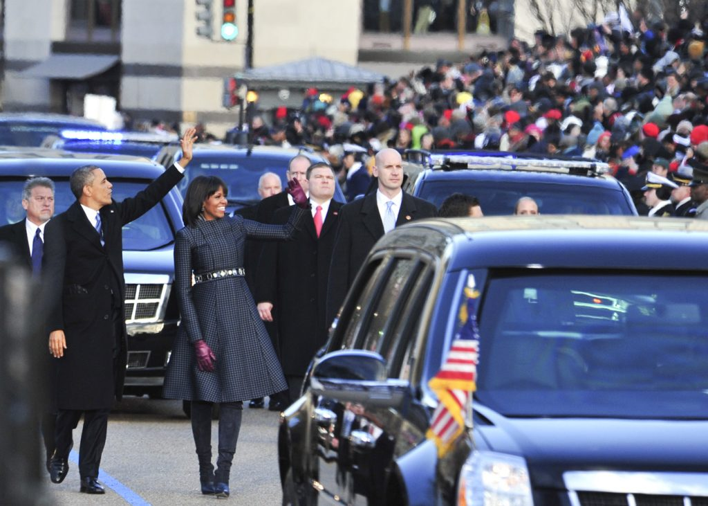 President Barack Obama and First Lady Michelle Obama greet parade attendants during the Inaugural Parade on Pennsylvania Avenue in Washington, D.C. following the swearing-in ceremony.