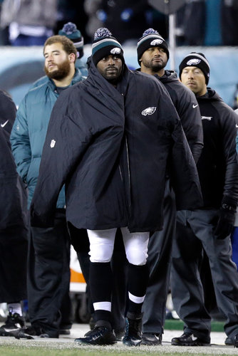Michael Vick stood like a spectator on the sidelines of the Eagles' wild-card loss to the Saints, most likely Vick's last game in a Philadelphia uniform. (Julio Cortez/Associated Press)