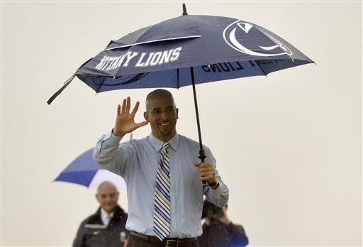 James Franklin waves to reporters and fans gathered at University Park Airport in State College, Pa. on Saturday, Jan. 11, 2014.  Penn State has hired Franklin as its next head coach. Franklin, 41, who led Vanderbilt to bowls in all three of his seasons there, replaces Bill O'Brien, who left the Nittany Lions after two years to coach the NFL's Houston Texans. Penn State made the announcement Saturday, after the school's compensation committee met to finalize the contract.  (AP Photo/Centre Daily Times, Christopher Weddle)
