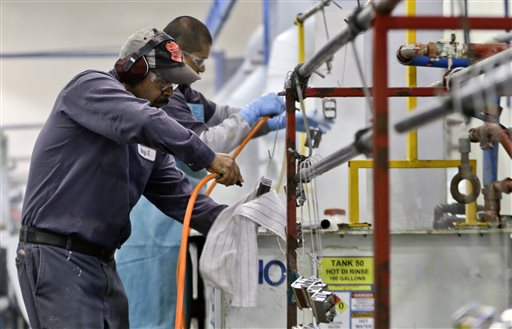 In this Thursday, Oct. 10, 2013, file photo, employees at Sheffield Platers Inc. work on the factory floor in San Diego. The Commerce Department releases fourth-quarter gross domestic product on Thursday, Jan. 30, 2014 (AP Photo/Lenny Ignelzi, File)